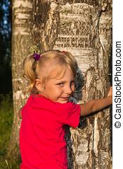 little girl hug a tree