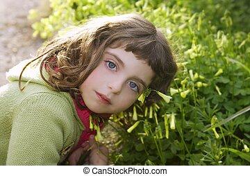 little girl hug grass happy in green meadow