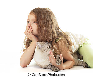 Little girl hugged her cat and dreaming.