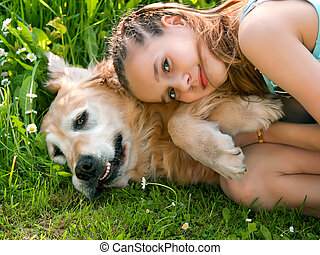 Little girl hugging a big dog