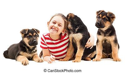 girl hugging a puppy