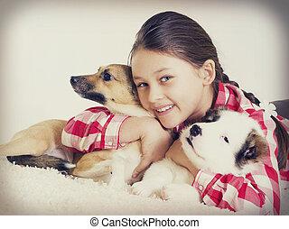 little girl hugging a puppy