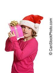 little girl hugging christmas gift