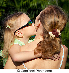 little girl hugging his mother