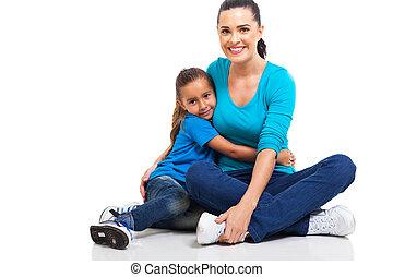 little girl hugging mother