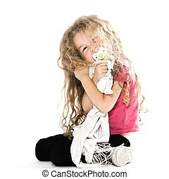 Little girl hugging pacifier