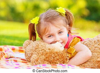 Little girl hugging soft toy