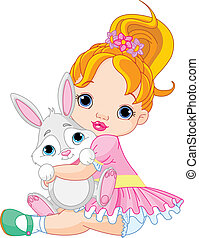 Little girl hugging toy bunny - Cute little girl hugging toy...