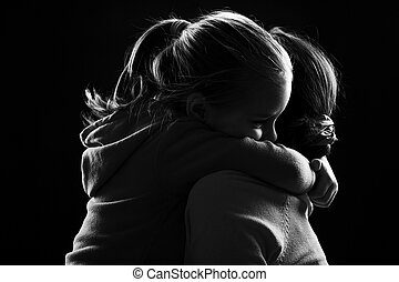Little girl hugs her mother - Black and white image of a...