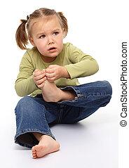 Little girl hurt her tiptoe, feeling pain, isolated over...