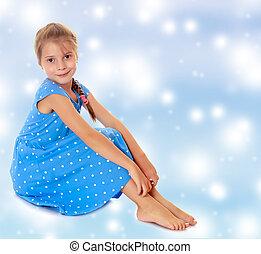 Little girl in a blue dress