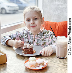 Little girl in a cafe