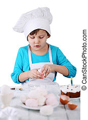 little girl in a cap Chef