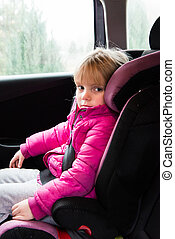 little girl in a car seat