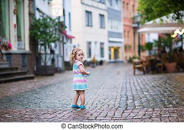 Little girl in a city