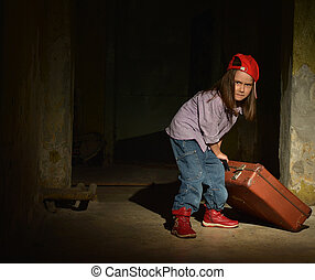 Little girl in a dark cellar