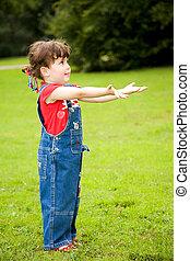 Little girl in a grassy meadow