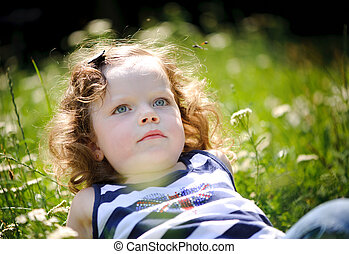 Little girl in a green field