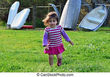 Little girl in a green field