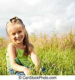 little girl in a meadow