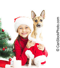 little girl in a New Year's suit hugging his dog on a white back