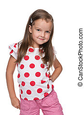 Little girl in a polka dot blouse