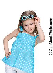 Little girl in a polka dot blue dress