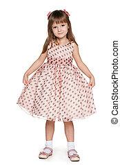 Little girl in a polka dot dress