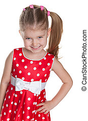 Little girl in a polka dot red dress