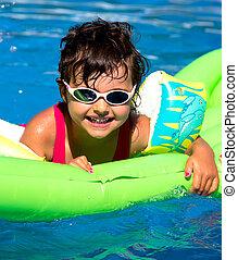 little girl in a pool