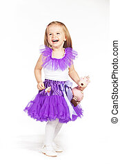 Little girl in a purple skirt