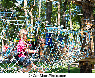 little girl  in a rope park