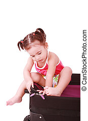 Little girl in a suitcase. Isolated on a white background
