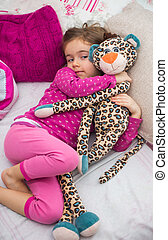 little girl in bed with toy