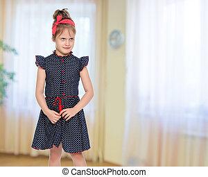 Little girl in blue polka dot dress.