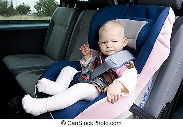little girl in car seat