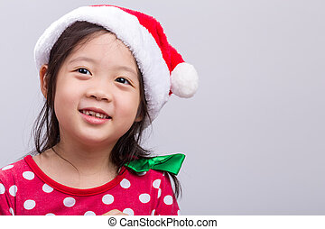 Little Girl in Christmas Costume with Santa Claus Hat