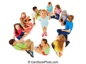 Little girl in circle of friends from above