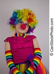 Little girl in clown costume.