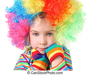 little girl in clown wig and multicolored gloves looking at camera, chin on hands, half body, isolated