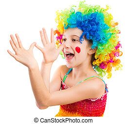 Little girl in clown wig fooling around