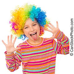 little girl in clown wig - smiling little girl shows tongue...