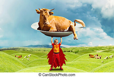 Little girl in costume holding a big cow