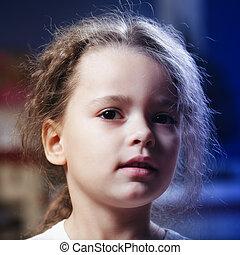 Little girl in darkness