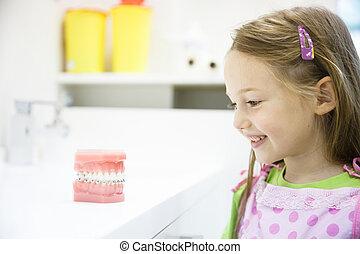 Little girl in dental office, smiling