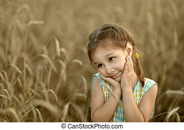 Little girl in field