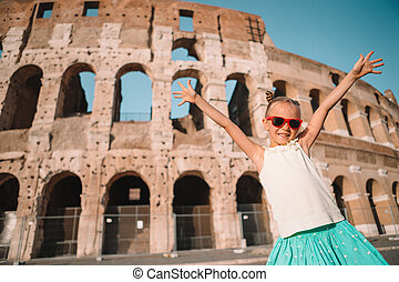 Little girl in front of colosseum in Rome, Italy