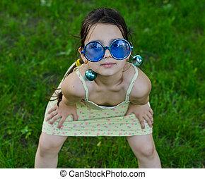 Little girl in funny glasses