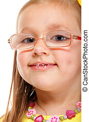 little girl in glasses doing fun isolated