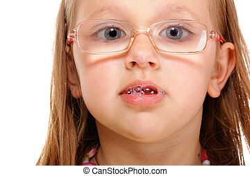 little girl in glasses doing fun isolated - Portrait smiling...